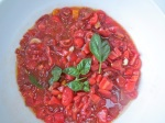Tomatoes macerating in salt and olive oil